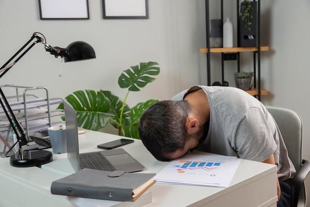 Man feeling sleepy while working from home