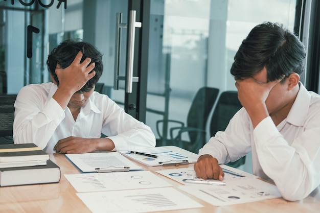Man feeling tired, frustrated stressed from hard work. exhausted businessman have headache
