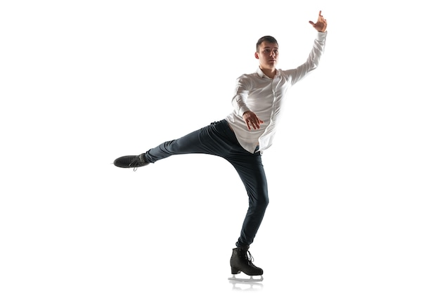 Man figure skating isolated on white studio backgound with copyspace.