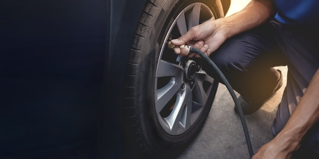 Man filling air into the tire