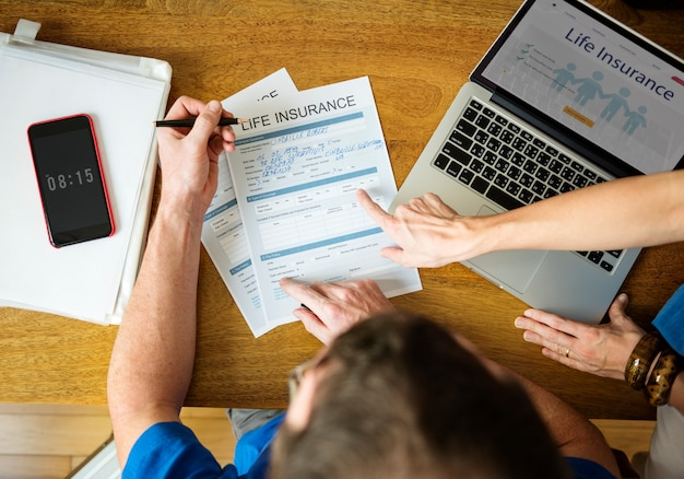 Man filling applicatio form documents information
