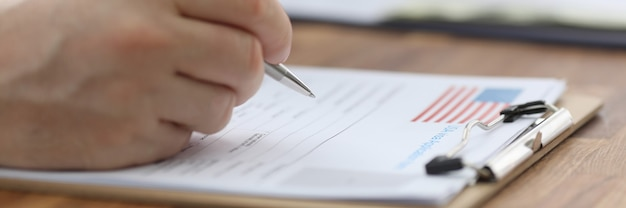 Man filling out documents for us visa closeup