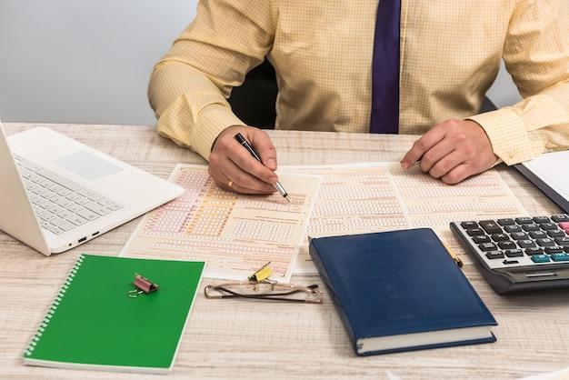 Man fills in australian tax forms financial concept