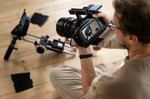 Man filming with a professional camera for a new movie