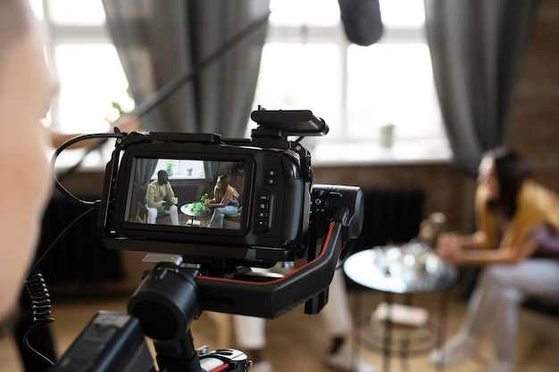 Man filming with a professional camera