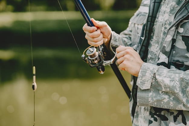 Man fishing and holds the angling rod