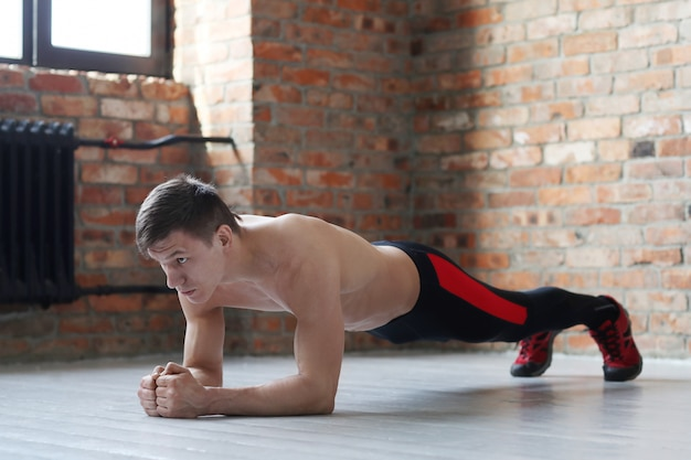 Man fitness workout. shirtless man doing stretching at home