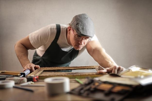 Man fixing a frame