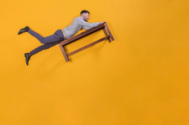 Man floating on a bench