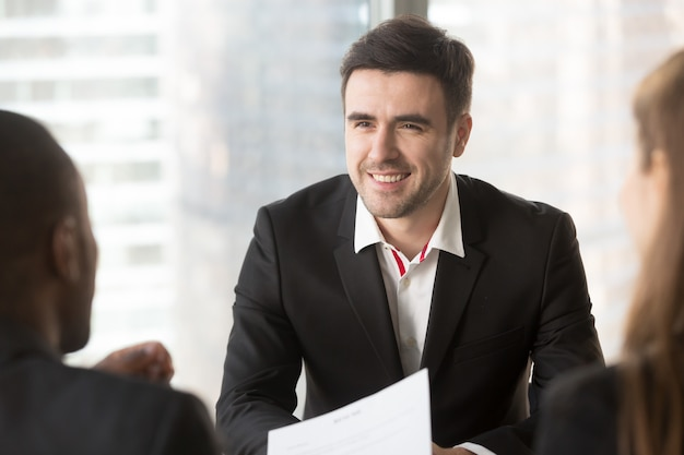 Man focusing on conversation with interviewers