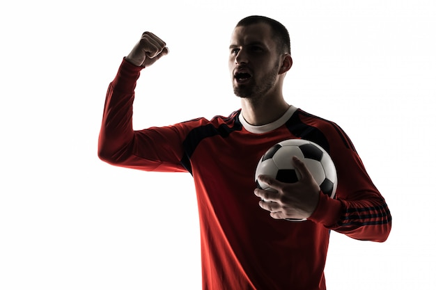 Man football soccer player silhouette in studio isolated on white stands with a ball victory