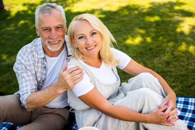 Man gently hugging woman high angle