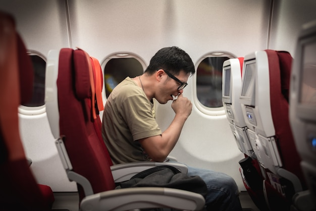 Man get sick during travel on airplane, possibility of corona virus outbreak