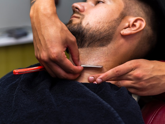 Man getting his beard cut