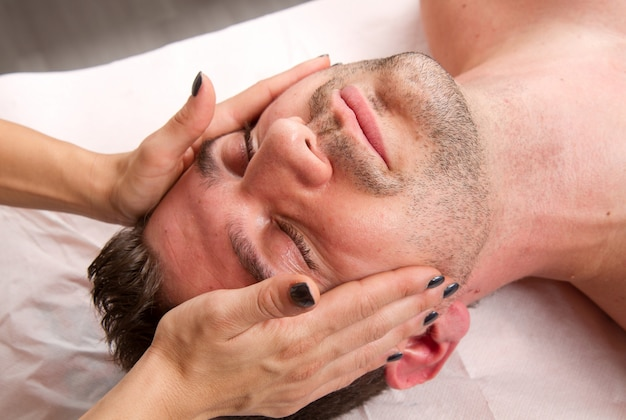 Man getting massage in thebeauty center