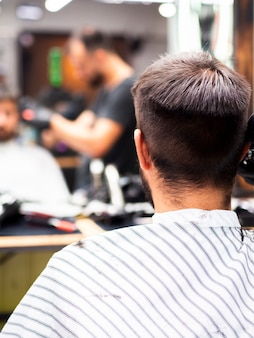 Man getting a new haircut from behind