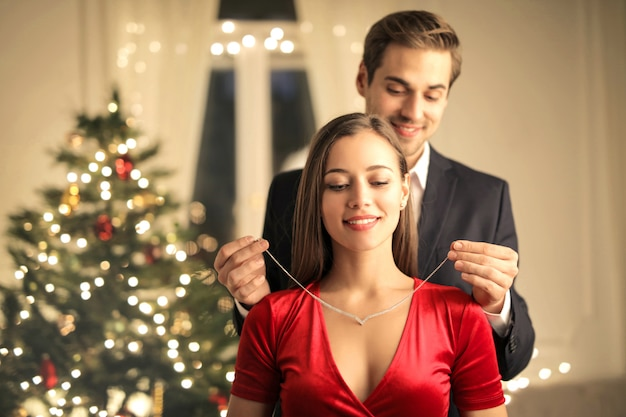 Man gifting a beautiful necklace to her girlfriend