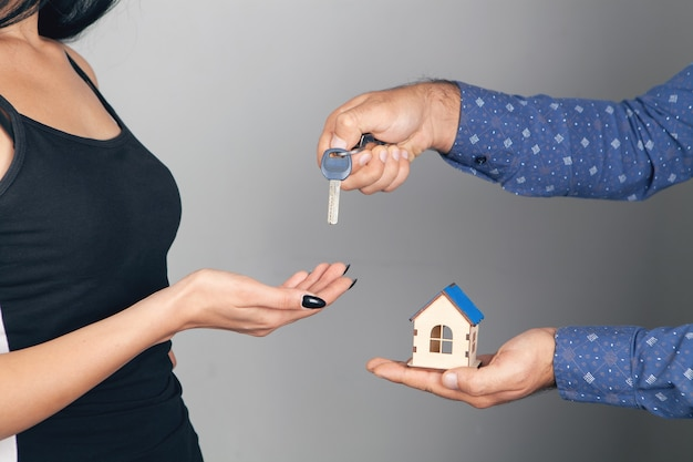 A man gives a house and keys to a woman