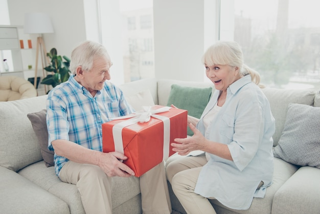 Man giving a big gift to his wife