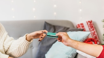 Man giving credit card to woman