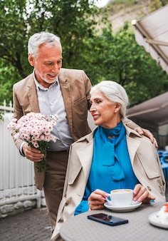Man giving flowers to her wife