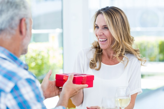Man giving gift box to wife