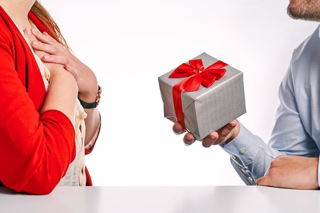 Man giving a gift to his partner. concept of valentine's day and couple in love.