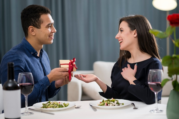 Man giving a gift to his wife for valentine's day