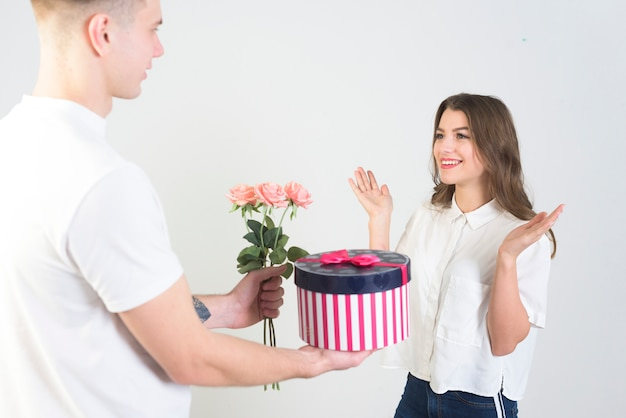 Man giving gifts to amazed woman
