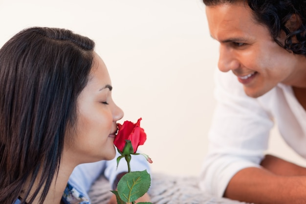 Man giving his girlfriend a rose for valentines day