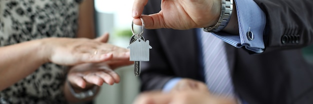 Man giving keys to new house owner
