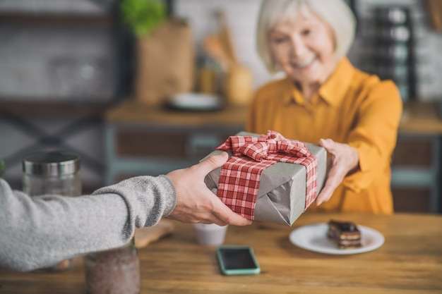 Man giving present to his mom