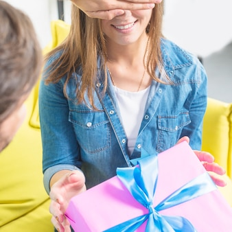 Man giving surprise gift to his girlfriend