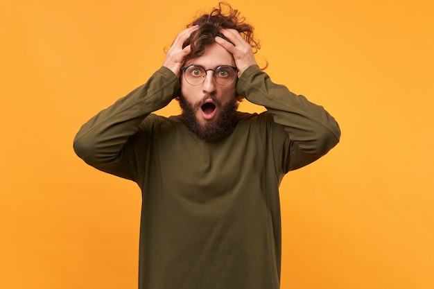 Man in glasses opened mouth in panic