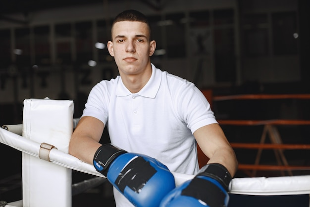 Man in a gloves. boxer in a sport clothes. guy in a t-shirt.