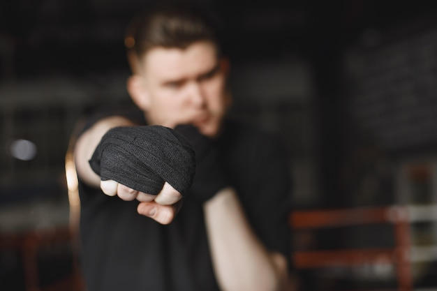 Man in a gloves. boxer in a sport clothes. guy with a beard.