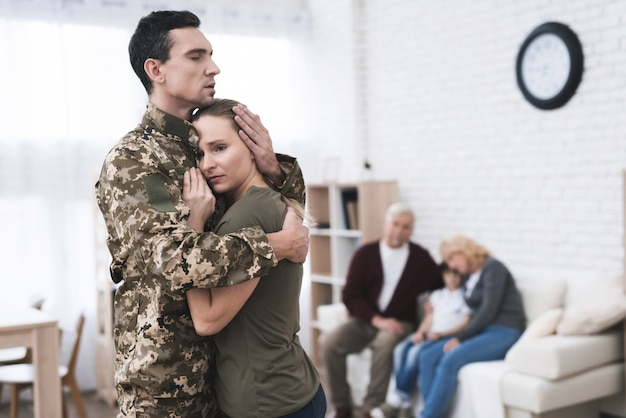 Man goes to military service and goodbye with wife.