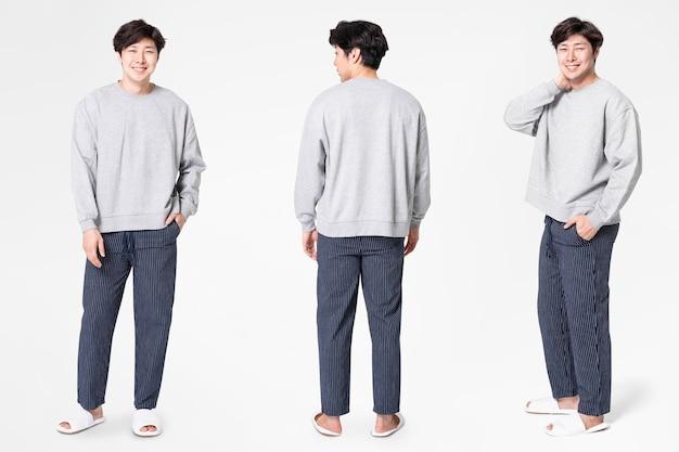 Uomo in maglione grigio e pantaloni abbigliamento da notte