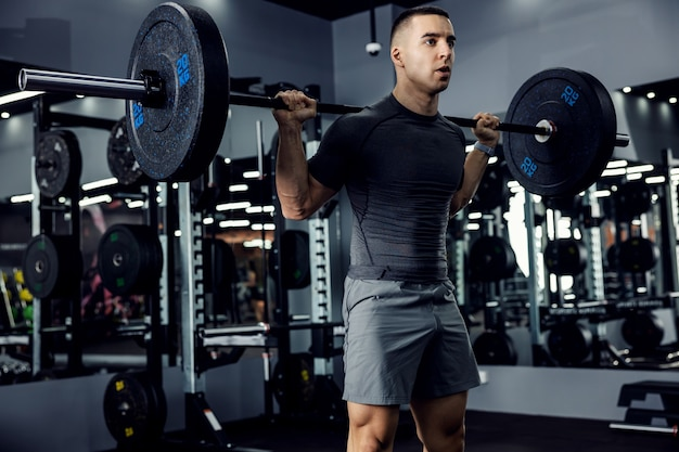 Man in the gym lifting weights