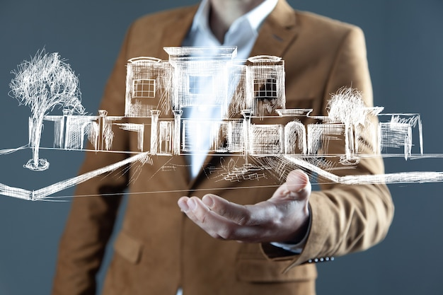 Man hand buildings in screen on grey background