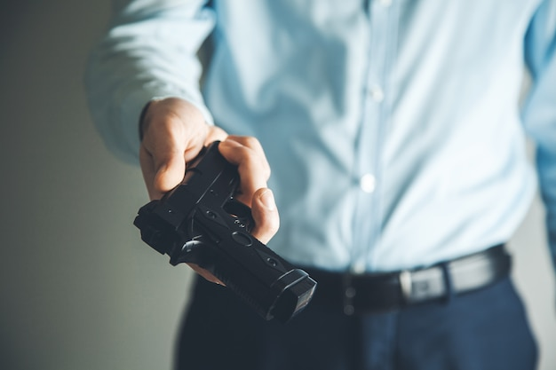 Man hand gun on dark