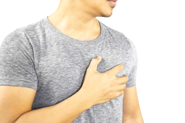 Man hand hold his chest  having heart pain isolated in clipping path.
