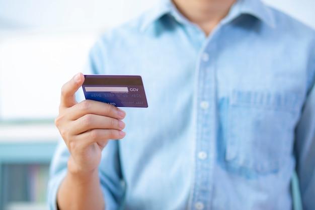 Man hand holding back credit card wear shirt