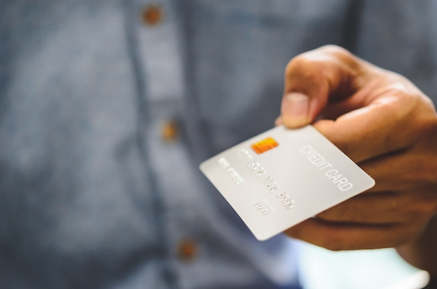 Man hand holding credit cards.online shopping by credit card.credit card loan application.