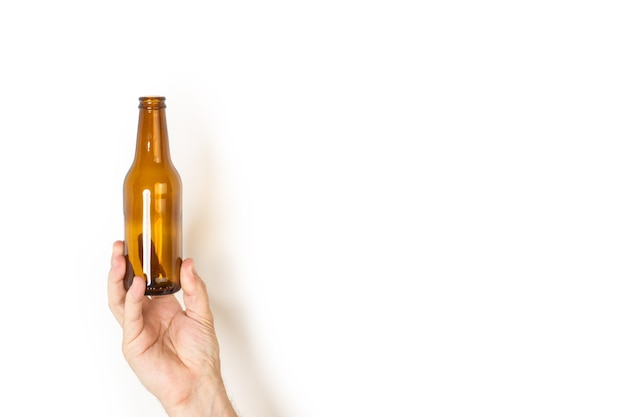 Man hand holding a empty bottle of beer
