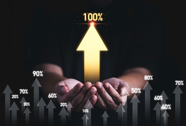 Man hand holding golden increasing arrow with percentage for business profit development growth to success concept.