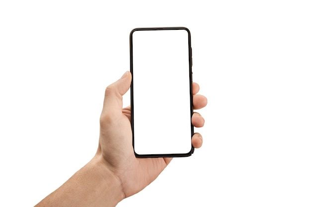 남자 손 빈 흰색 화면 및 현대 프레임 덜 디자인-흰색 배경에 고립 된 검은 휴대 전화 스마트 폰을 들고. 모형 전화. 휴대 전화를 들고 손