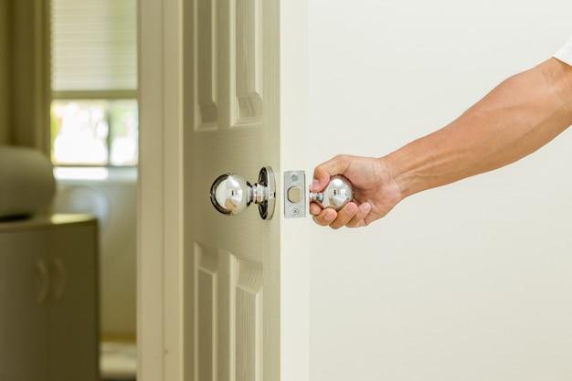 Man hand open door knob