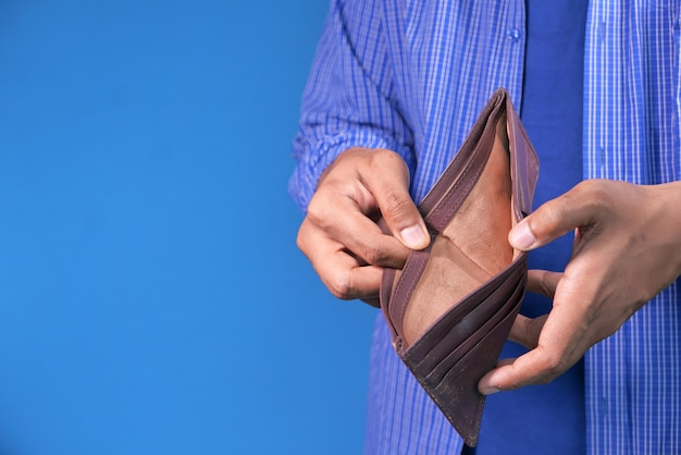 Man hand open an empty wallet with copy space.