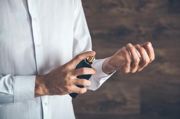 Man hand perfume on hand